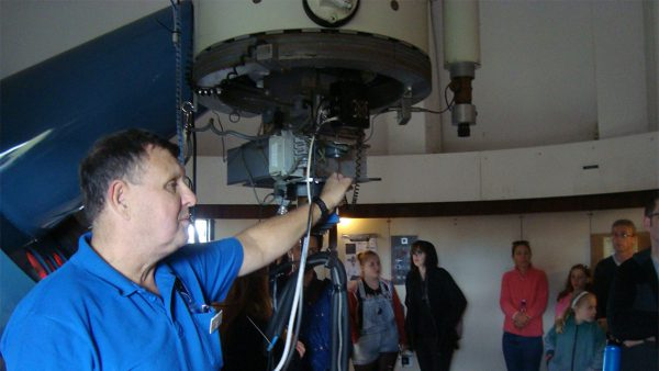 Ed talking about the lowell telescope. Image Credit: Geoff Scott