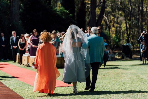 Francis and her parents walking down the aisle. Image Copyright: Michelle Lucking (Lucking Photography)