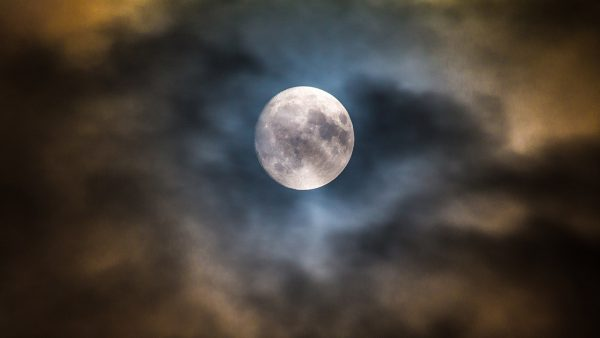Full Moon behind clouds. Image Credit Mark Golovko