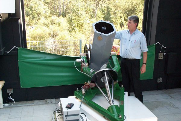 Dr Jamie Biggs with the Mike Candy Telescope. Image Credit: Perth Observatory