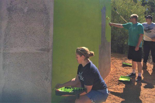 Hayley Fraser-Easton, James Grylls and Josh Crisp from Kalamunda Rotaract painting the outside of Worl Wangkiny. Image Credit: Edwin Sitt