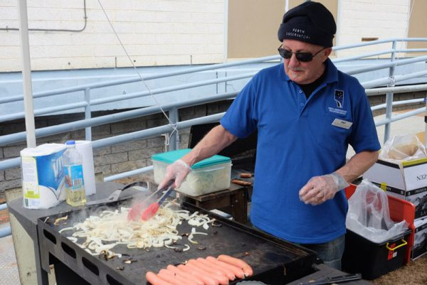 Volunteer Tad barbecuing. Image Credit: Geoff Scott